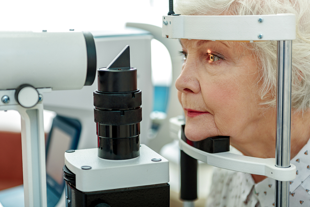 senior citizen receiving an eye exam